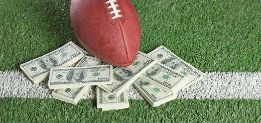 football and money on football field