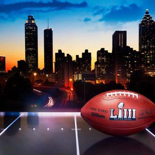 Super Bowl 53 football in front of Atlanta skyline