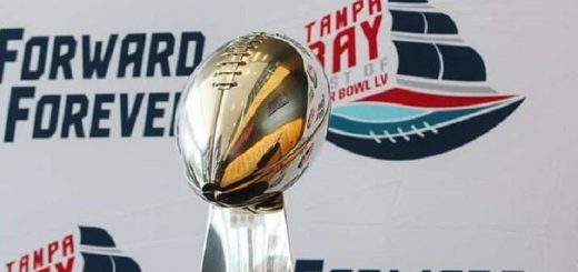 nfl super bowl trophy in front of new tampa bay sb lv logo