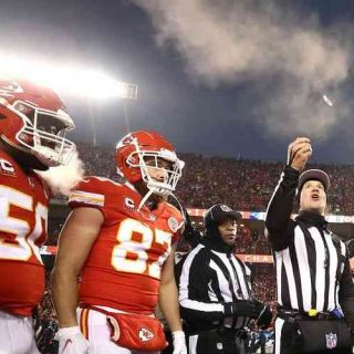 referee performing Super Bowl LV coin toss with Chiefs watching